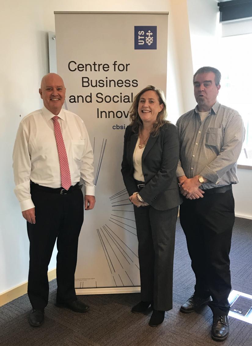 David Cooke, Bronwen Dalton and Brendan Lonergan in front of the CBSI banner