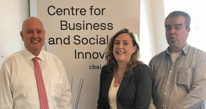 David Cooke, Bronwen Dalton and Brendan Lonergan in front of the CBSI banner