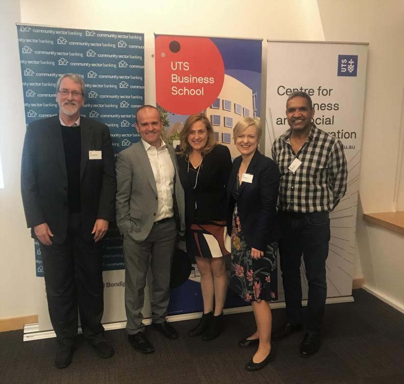 Chris Earley, Andrew Cairns, Bronwen Dalton, Verity Firth and Dean Jarrett stand in front of Community Sector Banking, UTS Business School and CBSI Banners