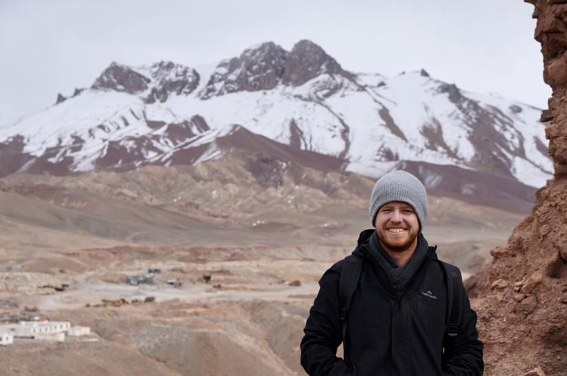 Mark Isaac in Afghanistan standing in front of mountains