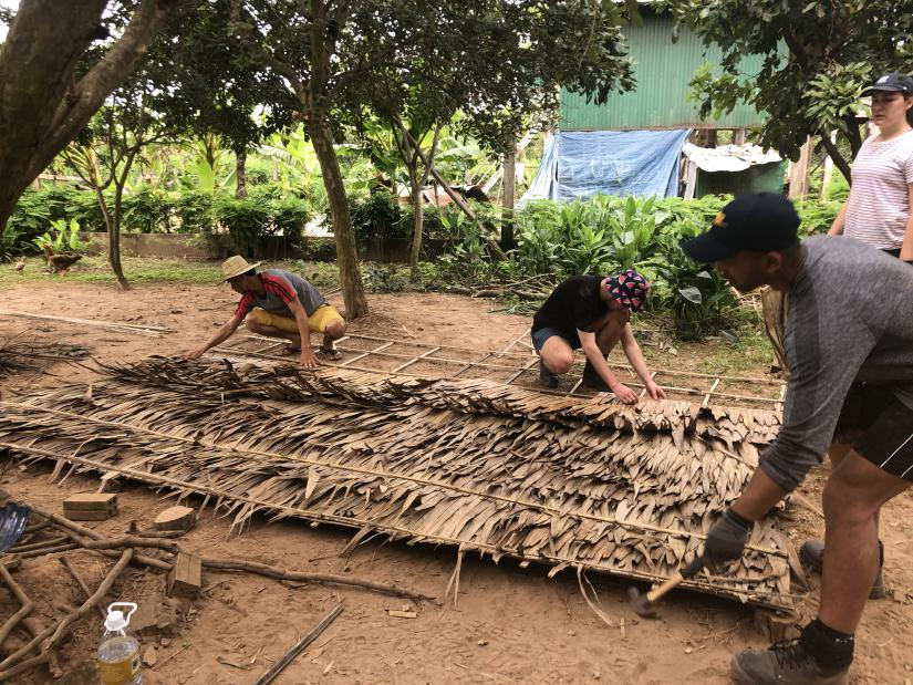 UTS students and Cambodian locals build a house by hand using local materials