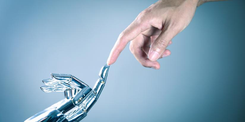Photo of a robot hand and human hand touching