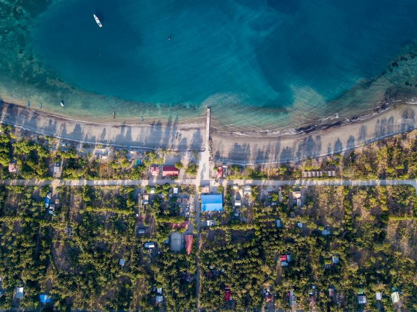 Aerial photo of houses and a beach in Timor-Leste