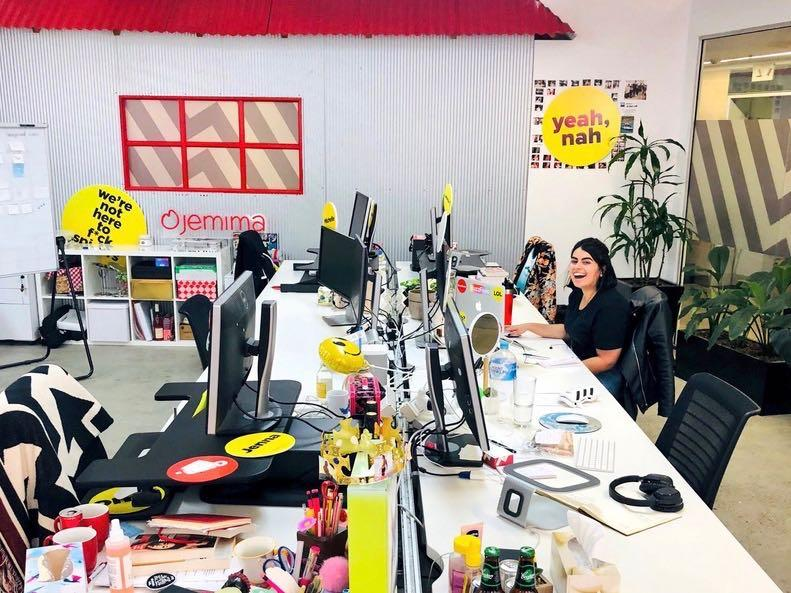 Isha sitting at her desk in the BuzzFeed office