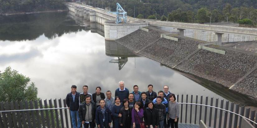 A group of people stand on the viewing platform overlooking Warragamba Dam