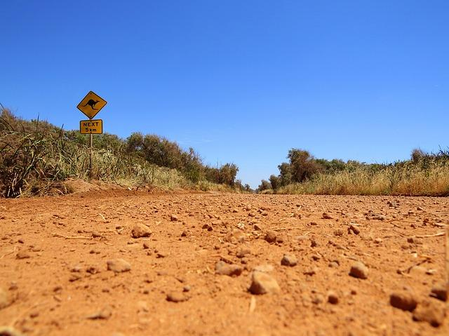 Dirt road in rural Australia, where people with disability face barriers to accessing NDIS support. Scott Avery, UTS