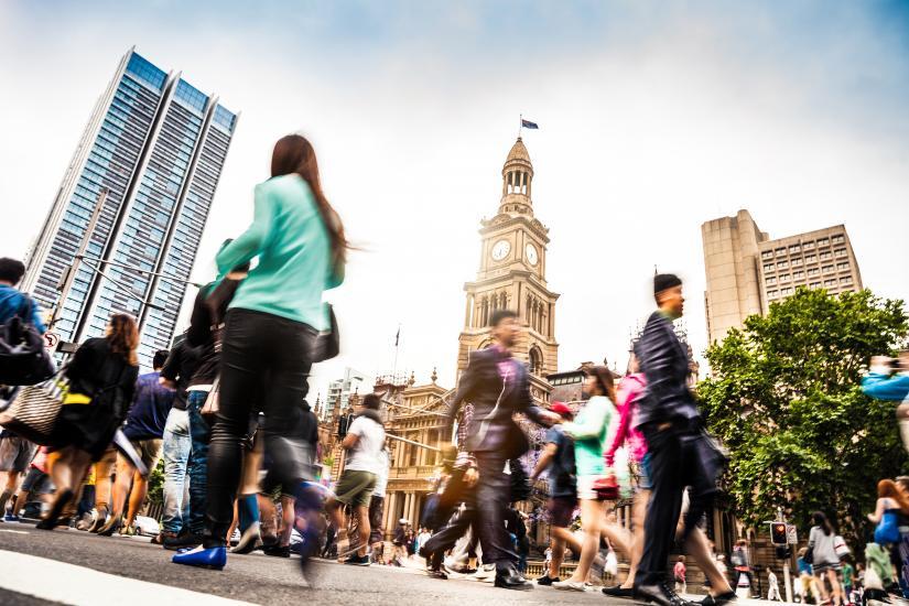 Pedestrians walking near Sydney's Town Hall