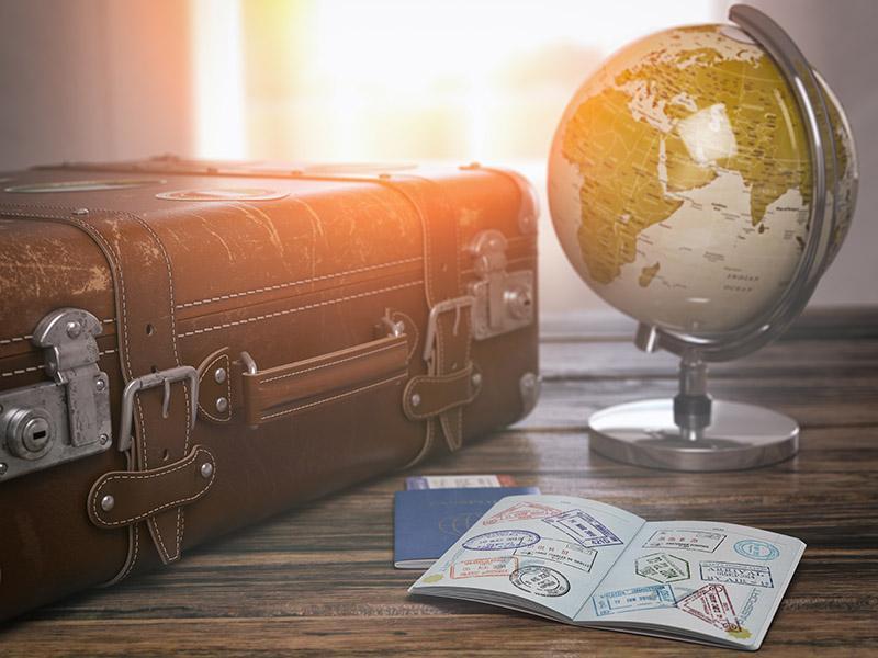 Suitcase, globe and passport