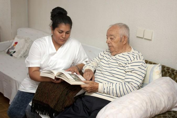Carer reads with man