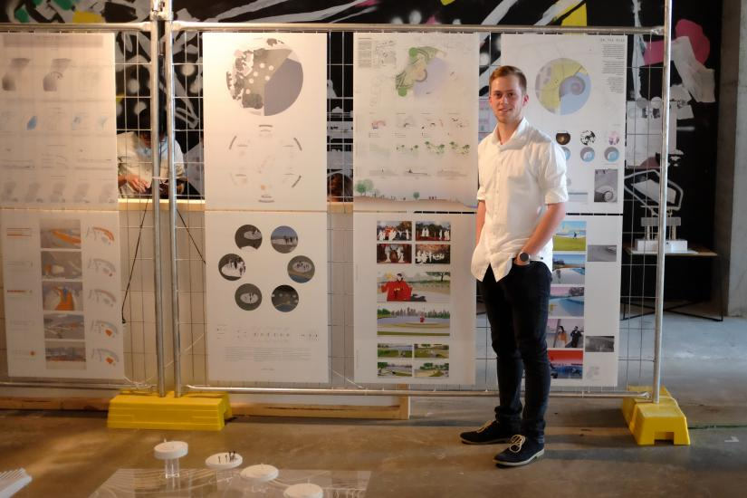 Landscape Architecture student Jeremy Chivas standing in front of his architectural panels at the 2016 UTS Festival of Architecture and Landscape