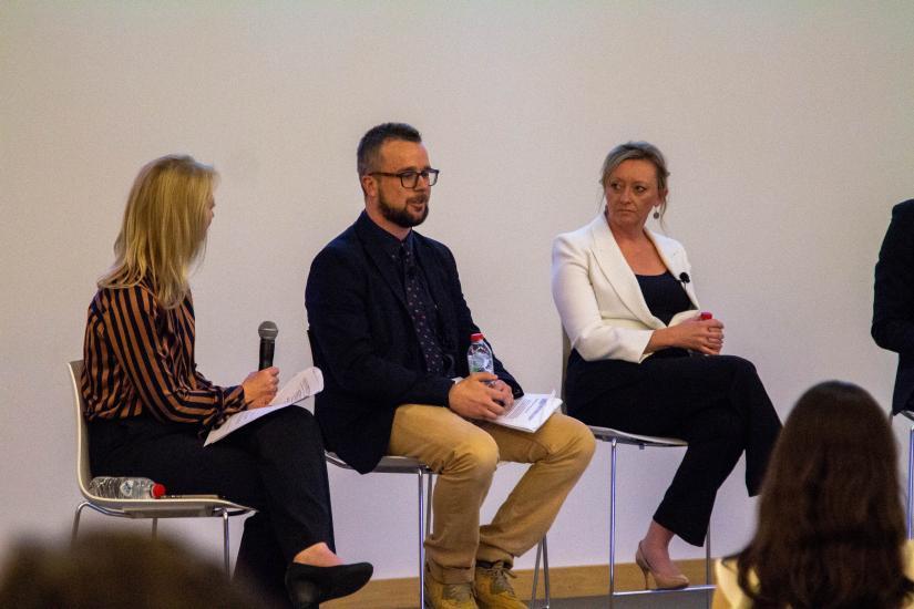 belinda middle week asking justin stevens a question on the panel as kylie merritt looks on