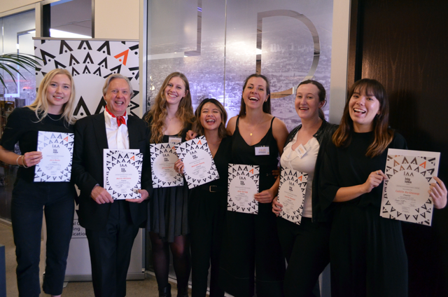 The Mill team, standing and holding their IAA Big Idea Certificates