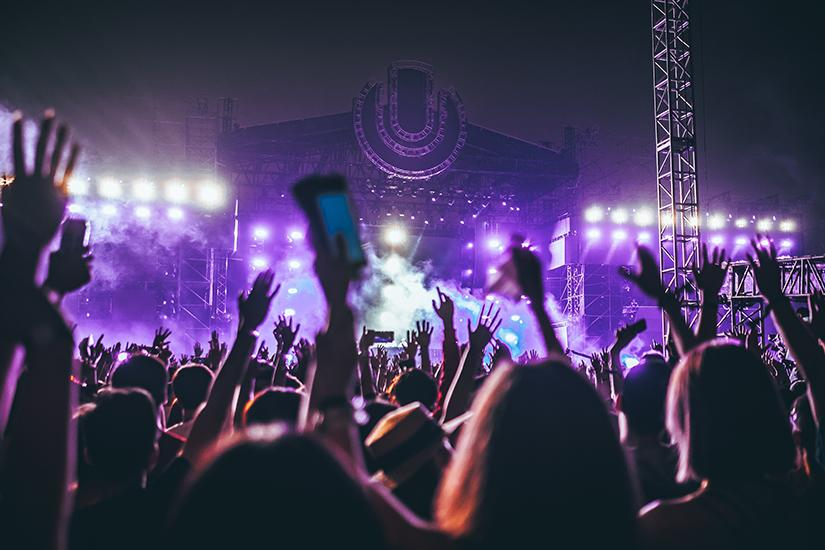 Photographs of people at a concert. Photo by Hanny Naibaho via unsplash.com