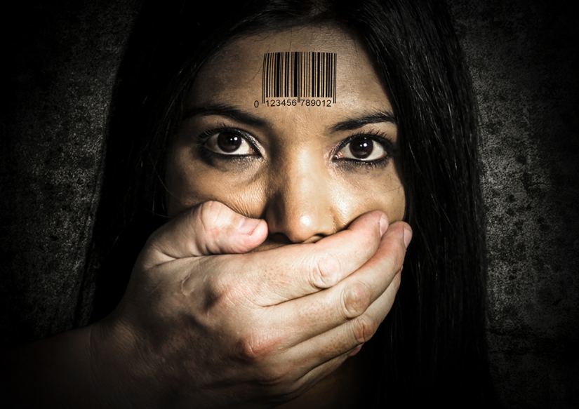 Hand covering woman's mouth, barcode on forhead