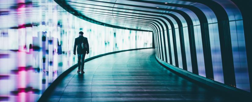 Person walking through tunnel.