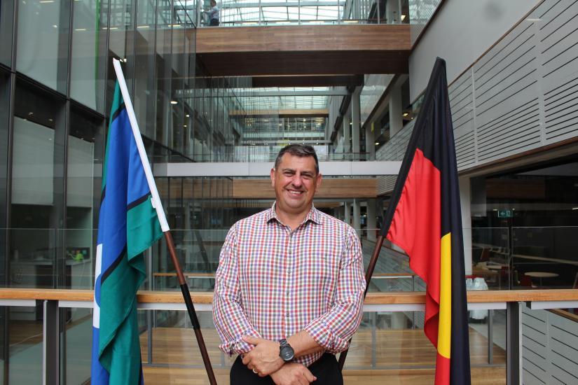 Scott Avery with ATSI flags