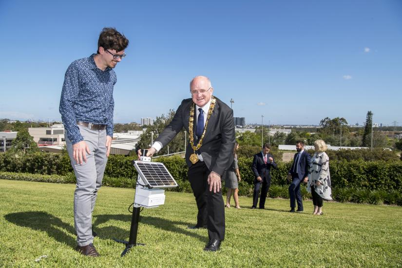 UTS Andrew Tovery and Lord Mayor Andrew Wilson stand in Melrose Park with a sensor