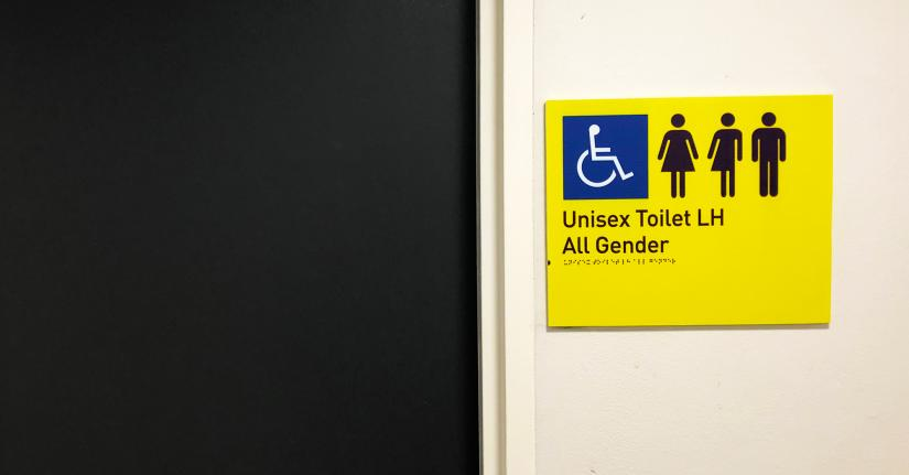 New all gender bathroom signs that includes a third gender-neutral symbol in addition to female and male symbols