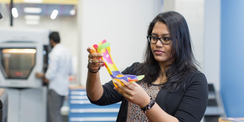 A student studies a 3D printed foot brace