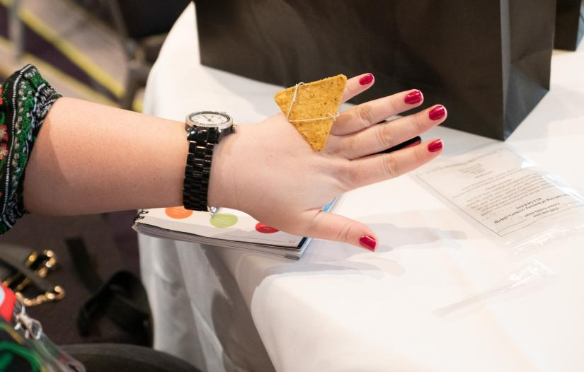 Deb Verhoeven wears a corn chip as a ring during her session