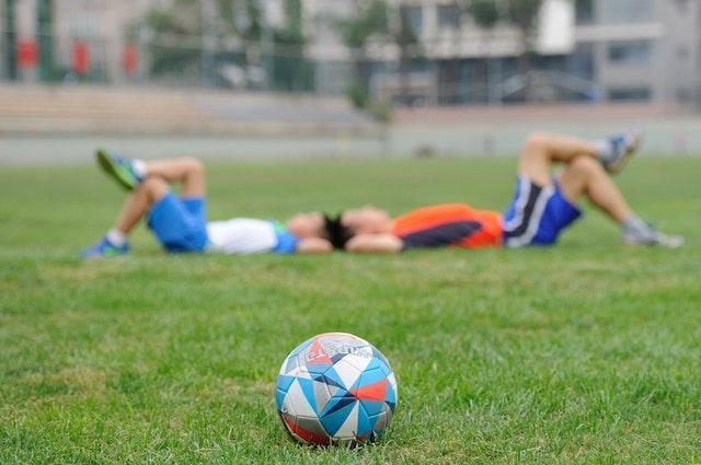 Two boys on football field
