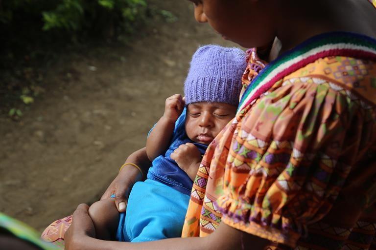 Mother cradling her baby