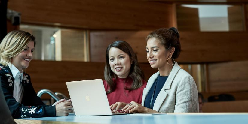 Three women on a laptop studying