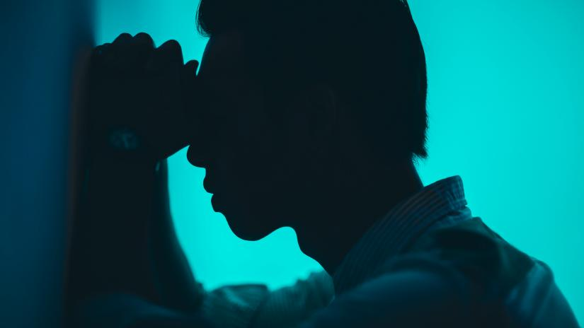Photo of a man looking distressed, by Raj Eiamworakul on Unsplash