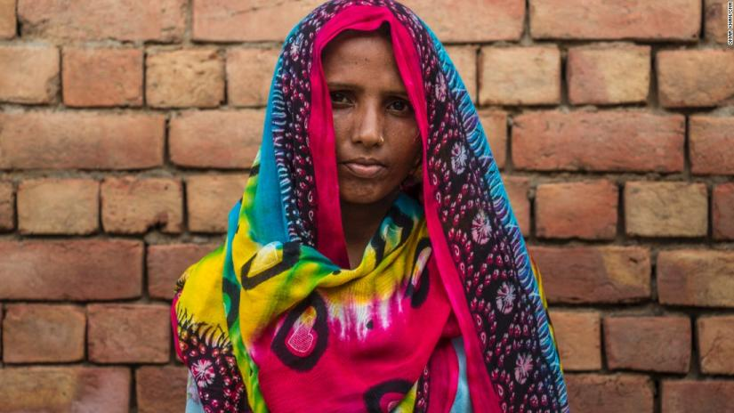 Headshot on Indian Dalit woman wearing a colourful head scarf.