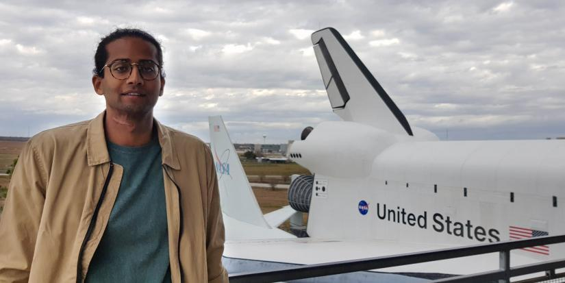Abhi standing in front of USA aircraft