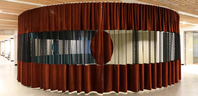 Dark red curtain around the exhibition and presentation space