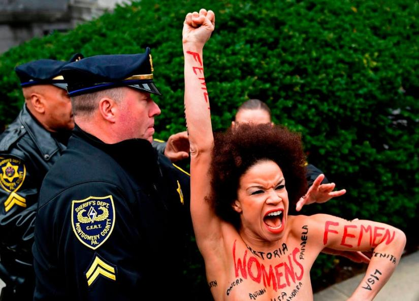 Actress Nicolle Rochelle, who appeared on several episodes of 'The Cosby Show', protesting while Police try to grab her.