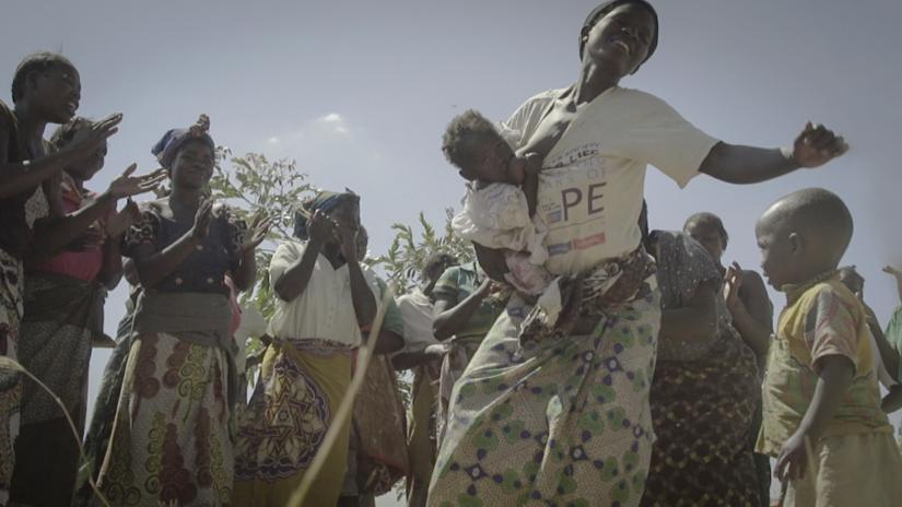 Still from Christel's film Mother: Malawi showing women dancing