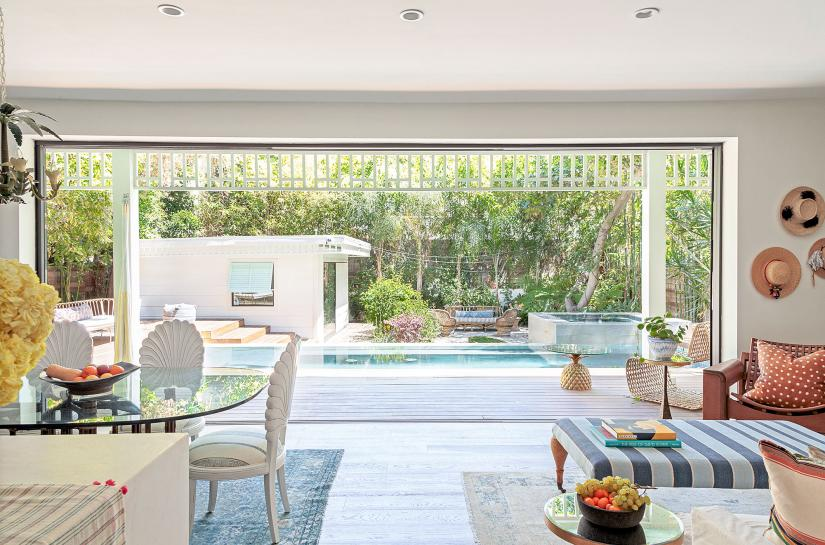 Bright living space looking out to a pool area