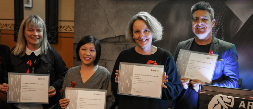 Four of the prize winners holding up their certificates