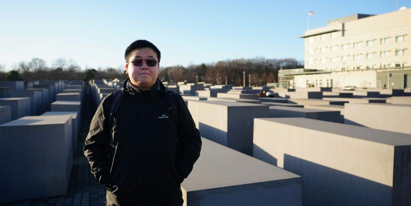 A man stands in front of the Memorial to the Murdered Jews of Europe