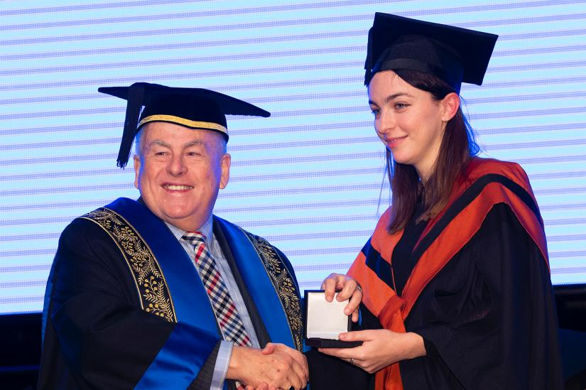 Freya being awarded the university medal at a graduation ceremony