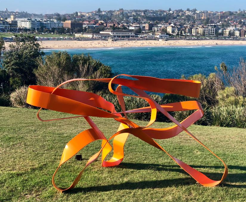 Jim Flook's sculpture Swerve One in front of a coastal backdrop
