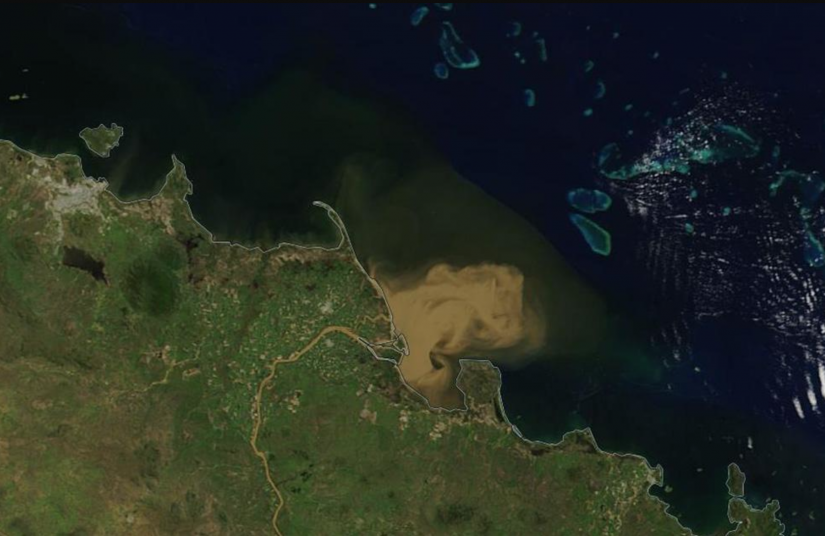 Summer flooding in Australia delivers significant freshwater runoff into the Coral Sea, raising concern for the Great Barrier Reef. Photo: USGS/NASA Landsat