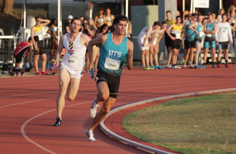 Two men running on a track, with UTS athlete Mason Cohen in the lead.