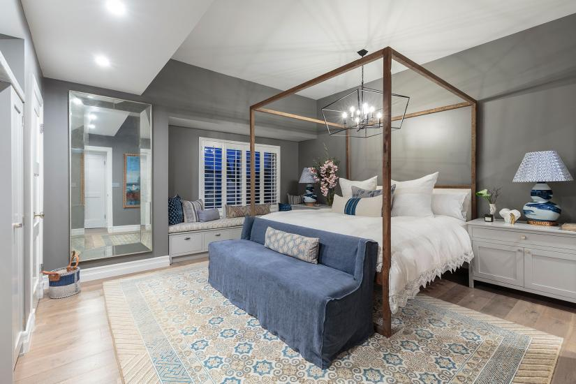 Bedroom interior designed with blues, greys and neutrals