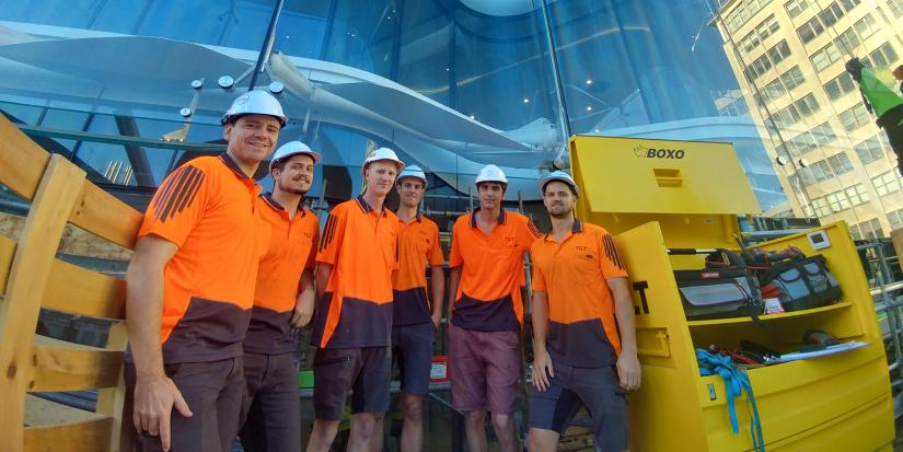 UTS interns Mads and Simon with members of the Tilt team standing on site in high-vis work shirts and hard hats