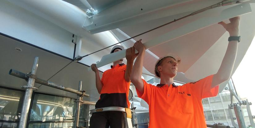 UTS student Mads Haugestad helps to assemble the sun shading used on the UTS Central building