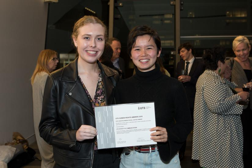 Two student representatives from the UTS Society of Communications receiving their Human Rights Award.