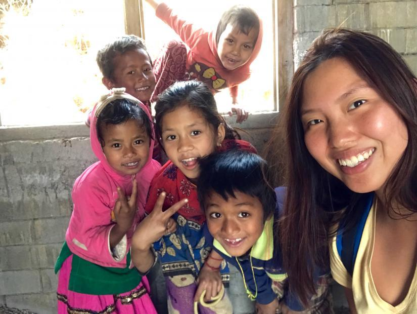 Won-Hae posing in Nepal with five young local children