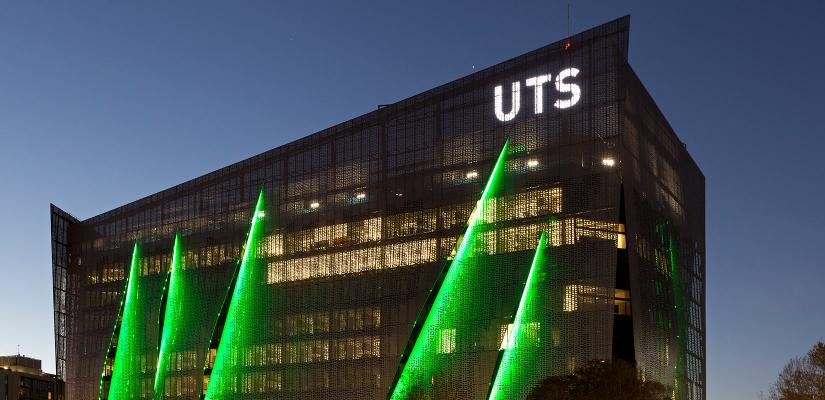 Illuminated FEIT building at night