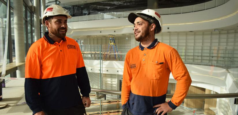 The Huckstadt brothers wear hard hats in the UTS Reading Room