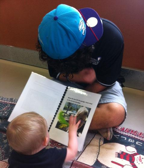 A Key College student reading to a young child.