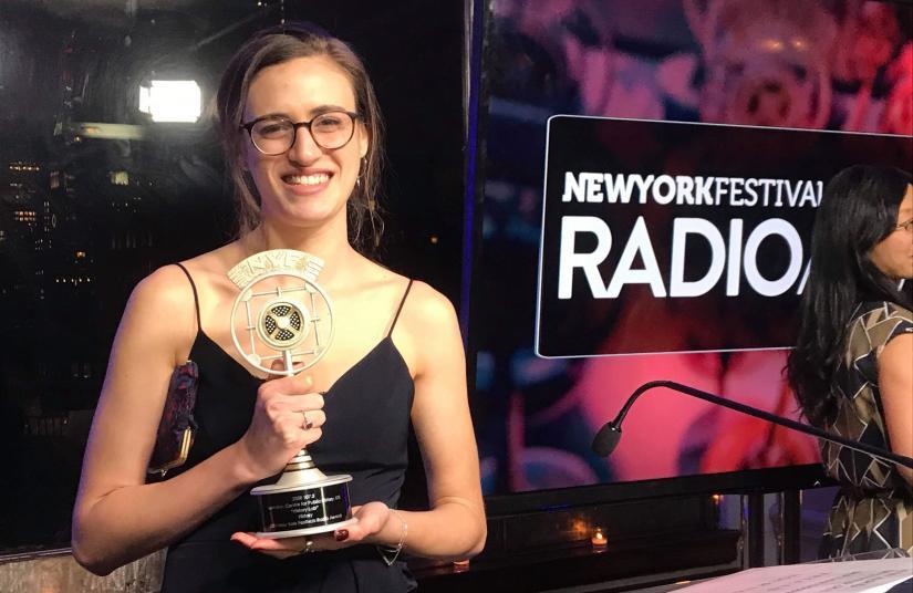 History Lab producer Ninah Kopel grasps the trophy at the New York Festivals Radio Awards