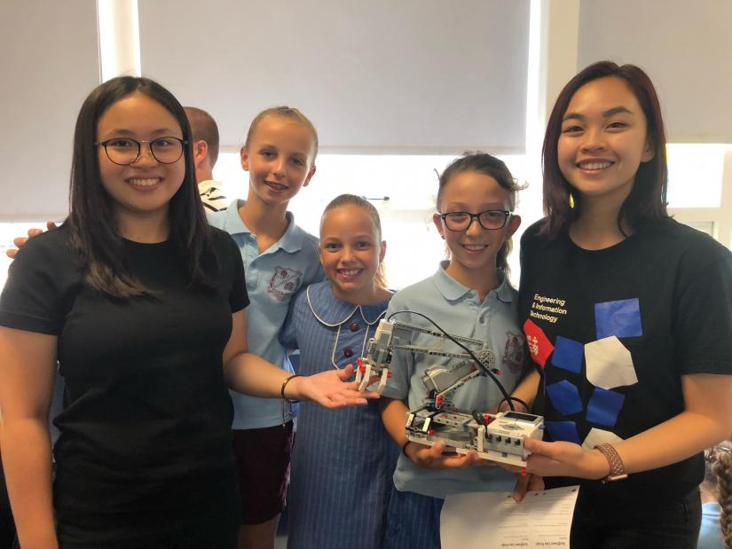 Young girls from Sutherland North Public School taking part in the STEM pilot, posing with UTS staff.